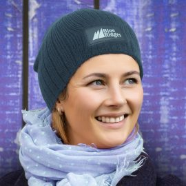 The Trends Collection Nebraska Cable Knit Beanie with Patch is a stylish cable knit beanie. Acrylic Yarn. 4 colours. Printing on patch. Great branded headwear.
