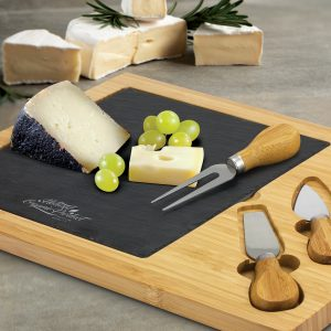 The Trends Collection Slate Cheese Board is a luxury bamboo cheese board with slate insert. 2 cheese knives and fork. Laser Engraved. Great corporate gifts.