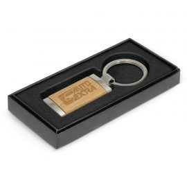 The Trends Collection Albion Key Ring is a rectangular metal key ring with chrome finish and wood plate. Laser Engraved or printed.  Branded key rings.