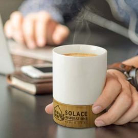The TRENDS Kismet Coffee Mug is a deluxe 250ml ceramic coffee cup with natural bamboo base. Printing on the bamboo. Black gift box.